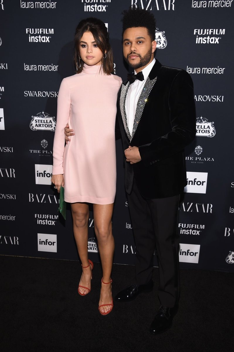 Selena Gomez is looking beautiful in the blush-tones turtle neck dress. The Weeknd is looking great in the black velvet suit. The two has called their relationship off, recently.