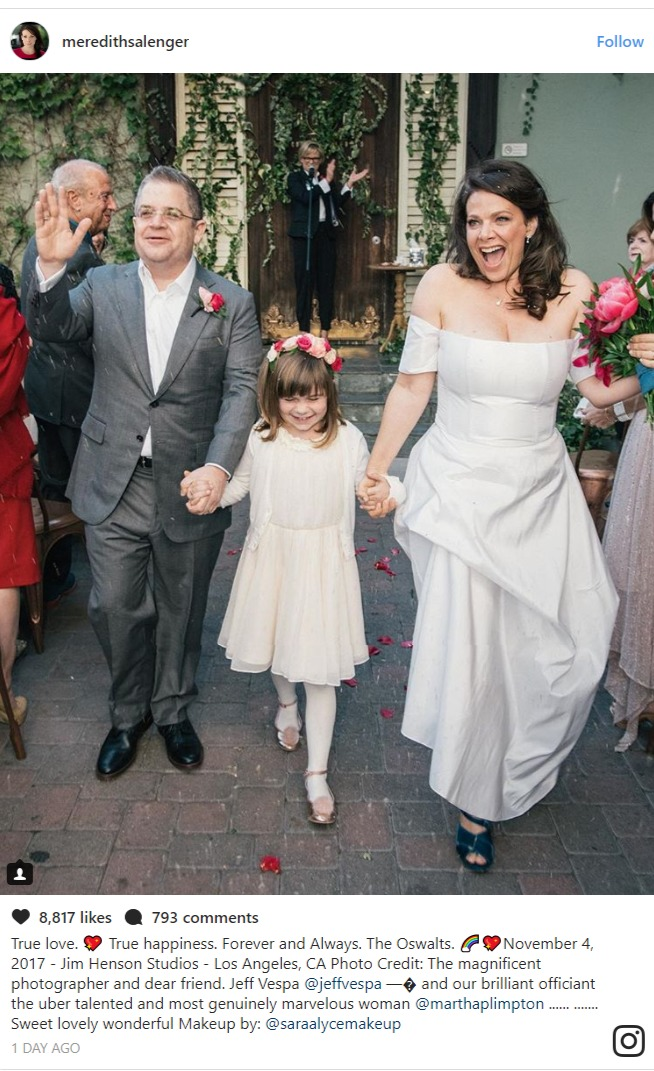 Meredith Salenger and Patton Oswalt holding hands with Oswalt's daughter Alice