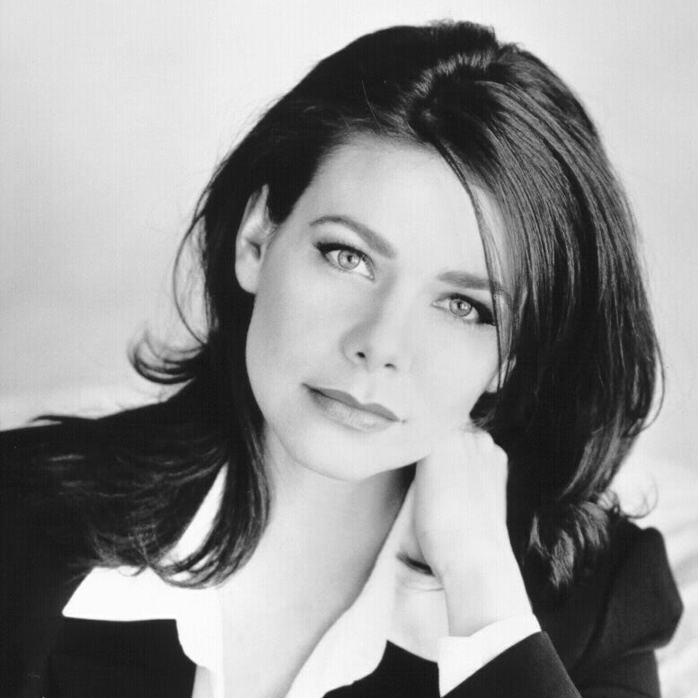Meredith Salenger posing for a camera during her photo shoot.