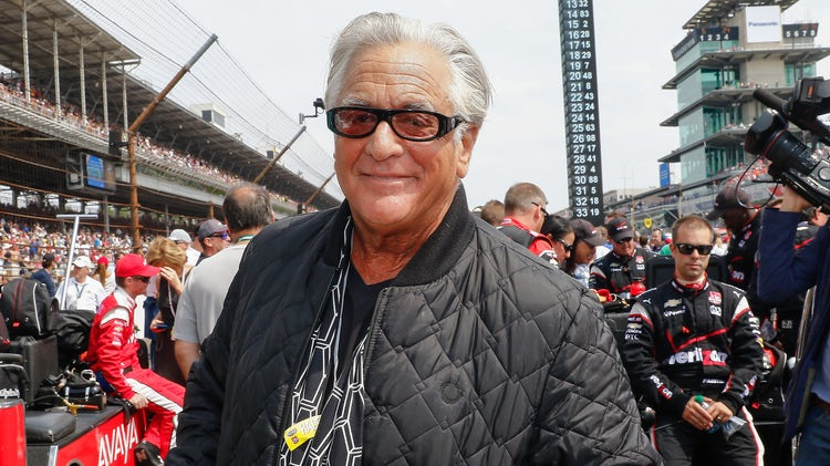 Barry Weiss is wearing a black bomber jacket