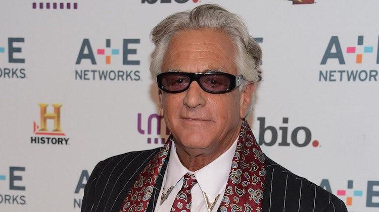 Barry Weiss is wearing a black spec