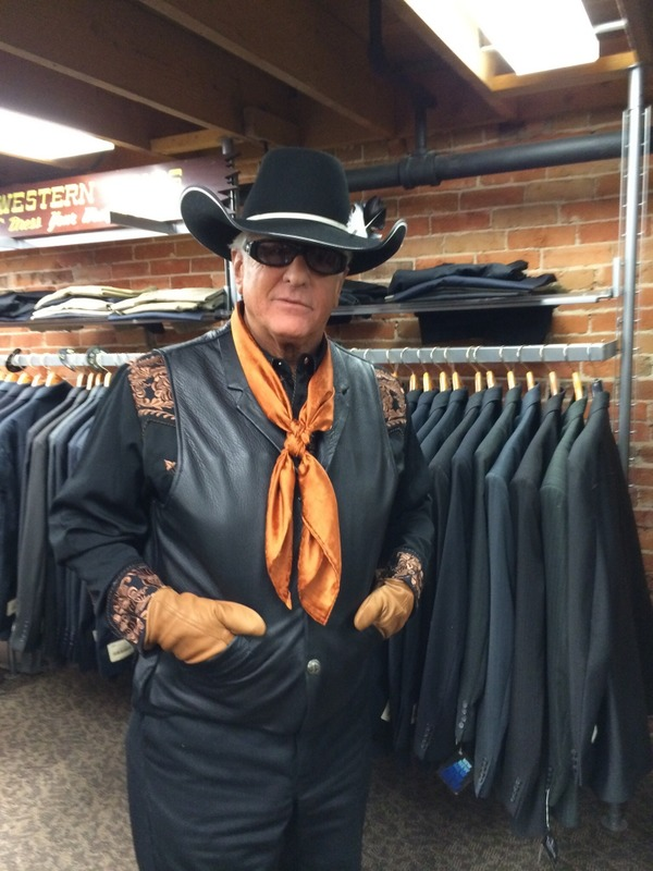 Barry Weiss is wearing a black hat followed by black leather half jacket