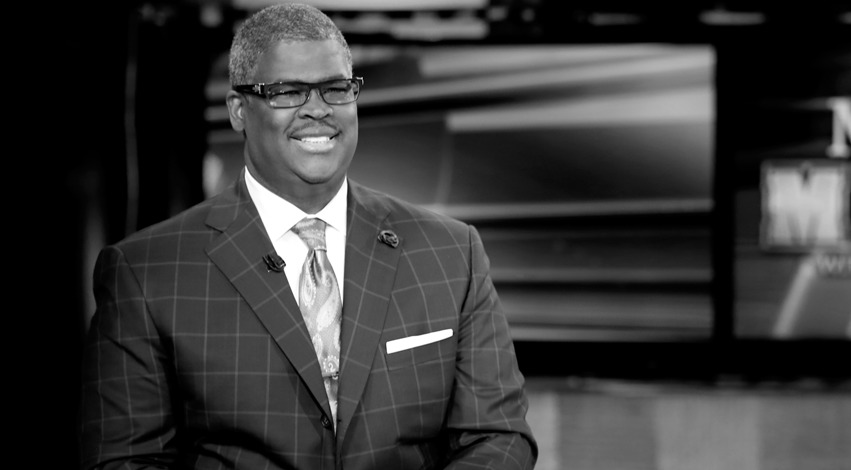 Black and white image of Charles Payne on the set of Making Money with Charles Payne