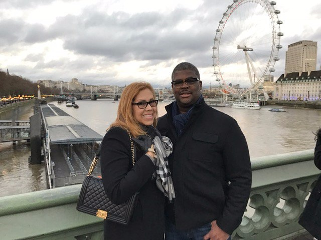 Charles Payne and his wife Yvonne Payne on the bridge in front a big merry-go-round