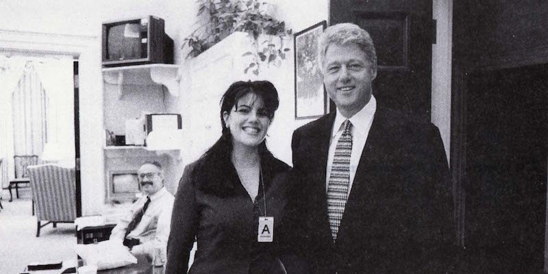 former White House Intern Monica Lewinsky and President Bill Clinton both smiling at the camera for a photograph