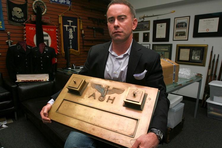 Craig Gottlieb holding a desk set used by Adolf Hi0lter