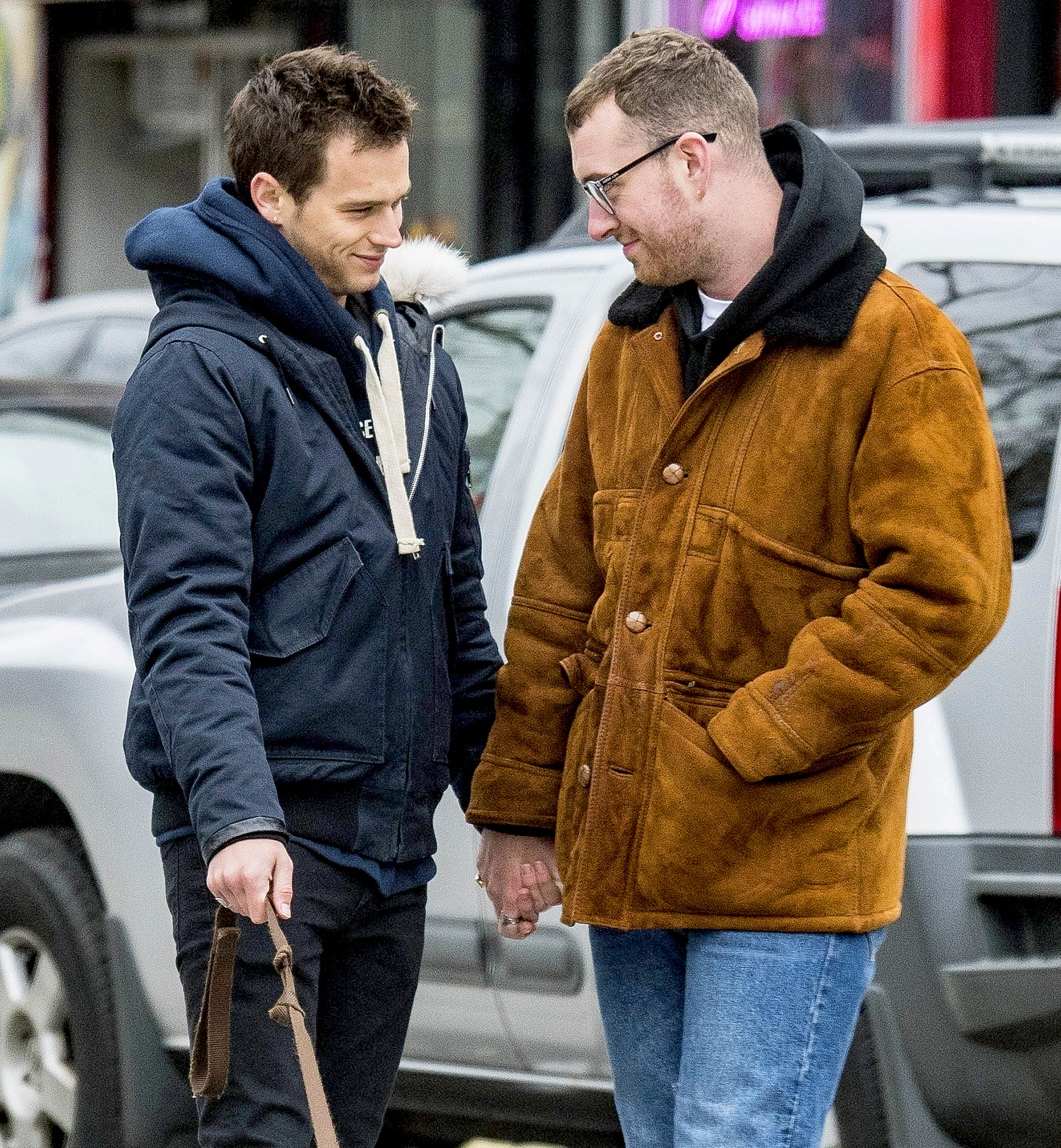 Brandon Flynn and  his boyfriend Sam Smith are holding each other's hand