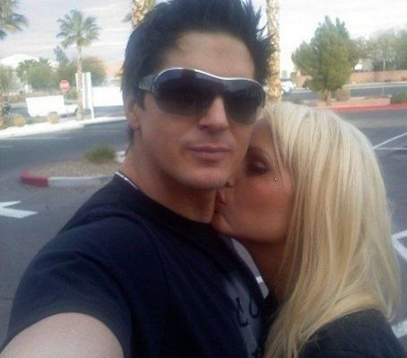 Christine Dolce is kissing Zak Dolce on his neck