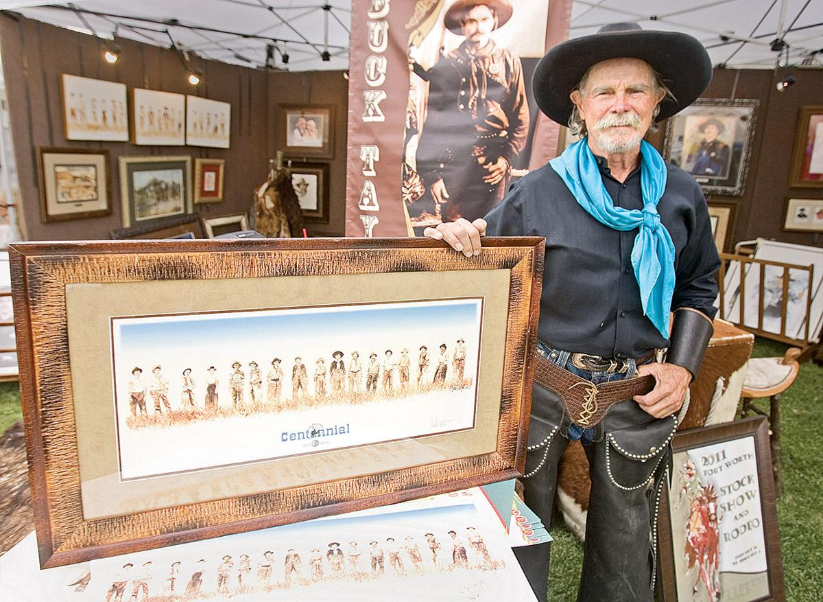 Buck Taylor standing alongside his painting. Gunsmoke star Buck Taylor is also a renowned artist known for his work of portraits and painting of wild west.