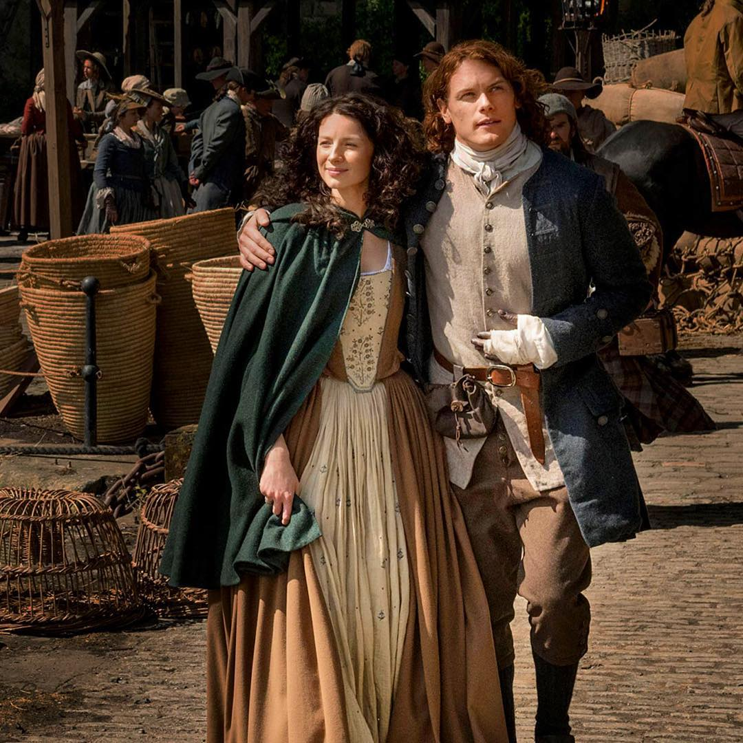 Caitriona Balfe (as Claire Randall) and Sam Heughan (as Jamie Fraser) on the set of Outlander