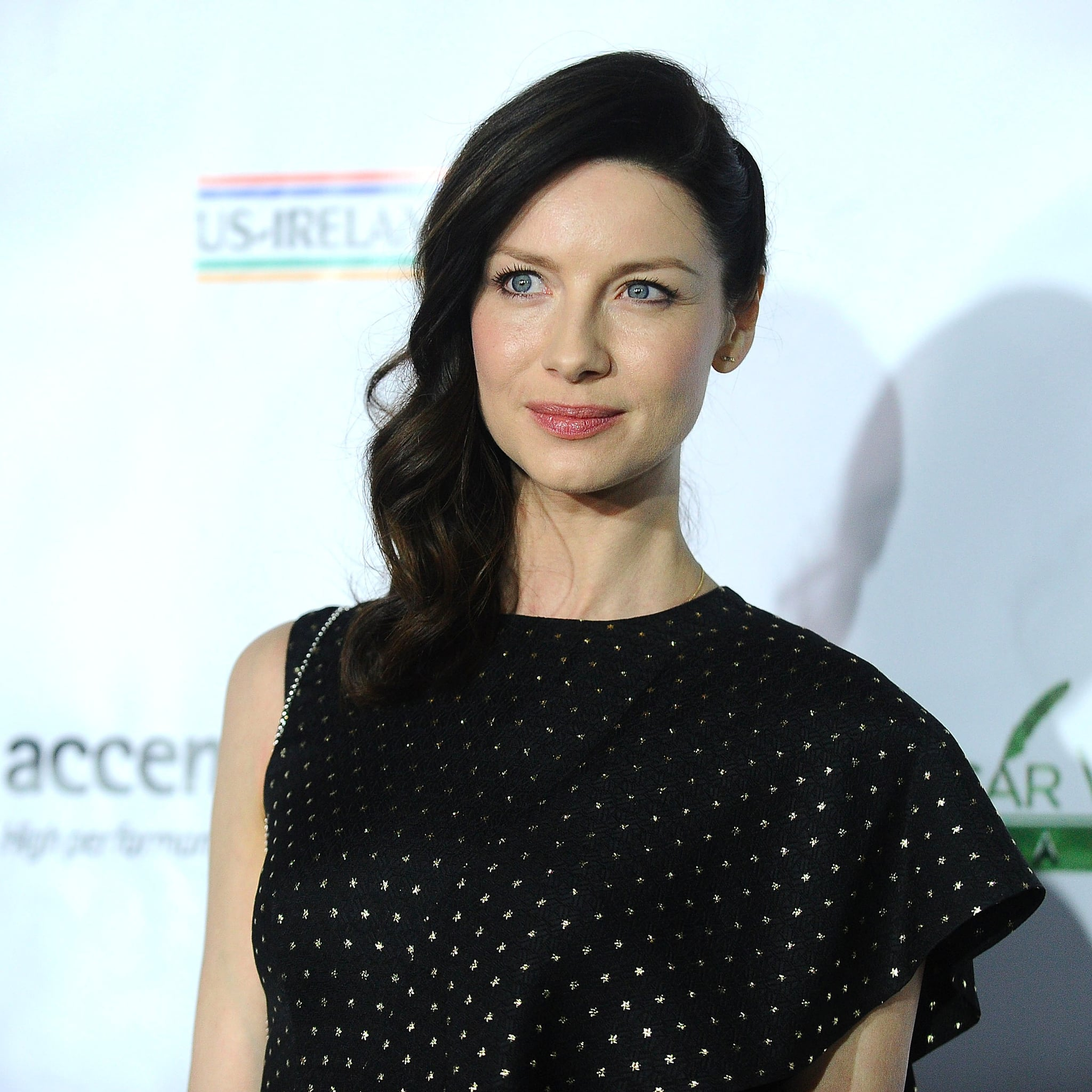 Balfe wearing a black dress and posing for a picture