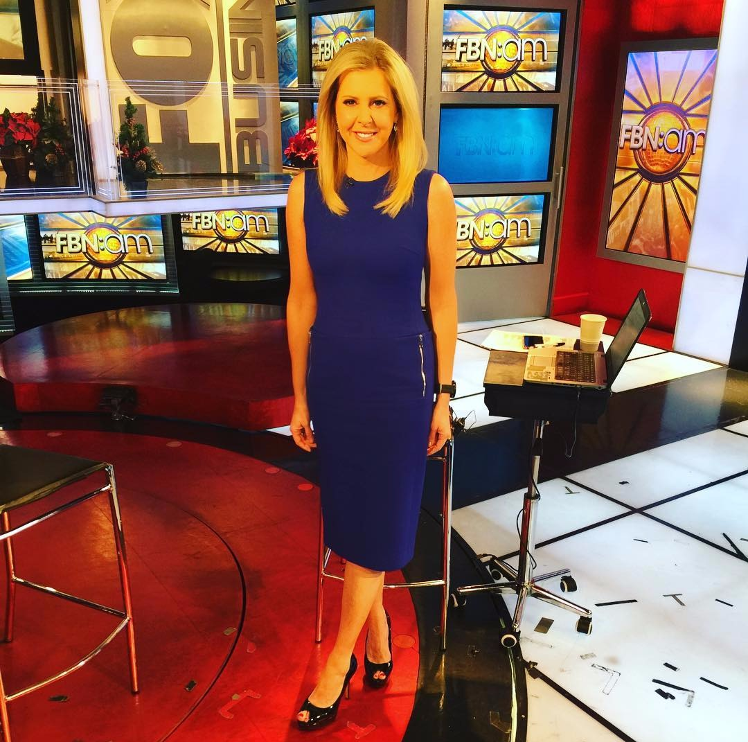 Cheryl Casone posing for a picture on the set of FBN:am