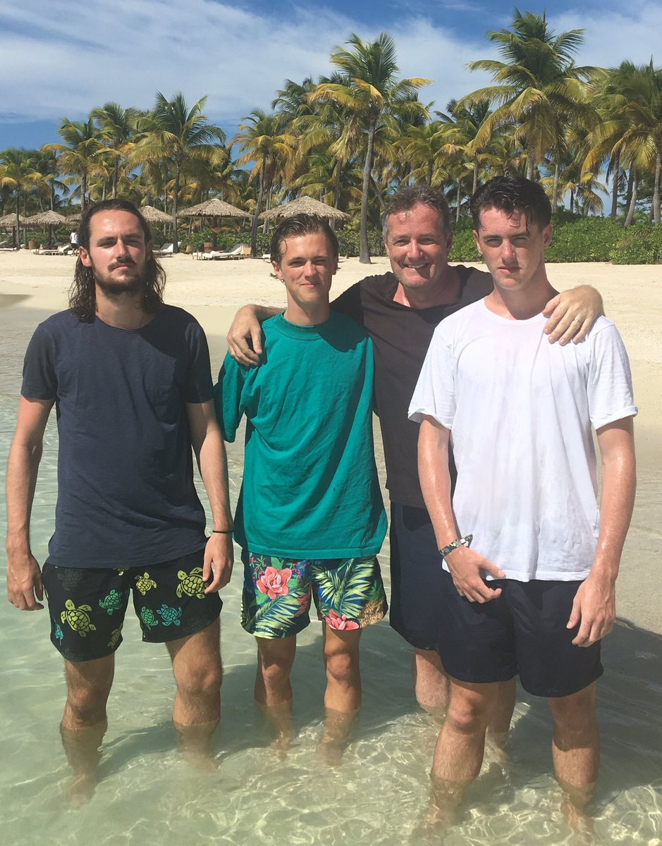 Piers Morgan posing on a beach with his three sons