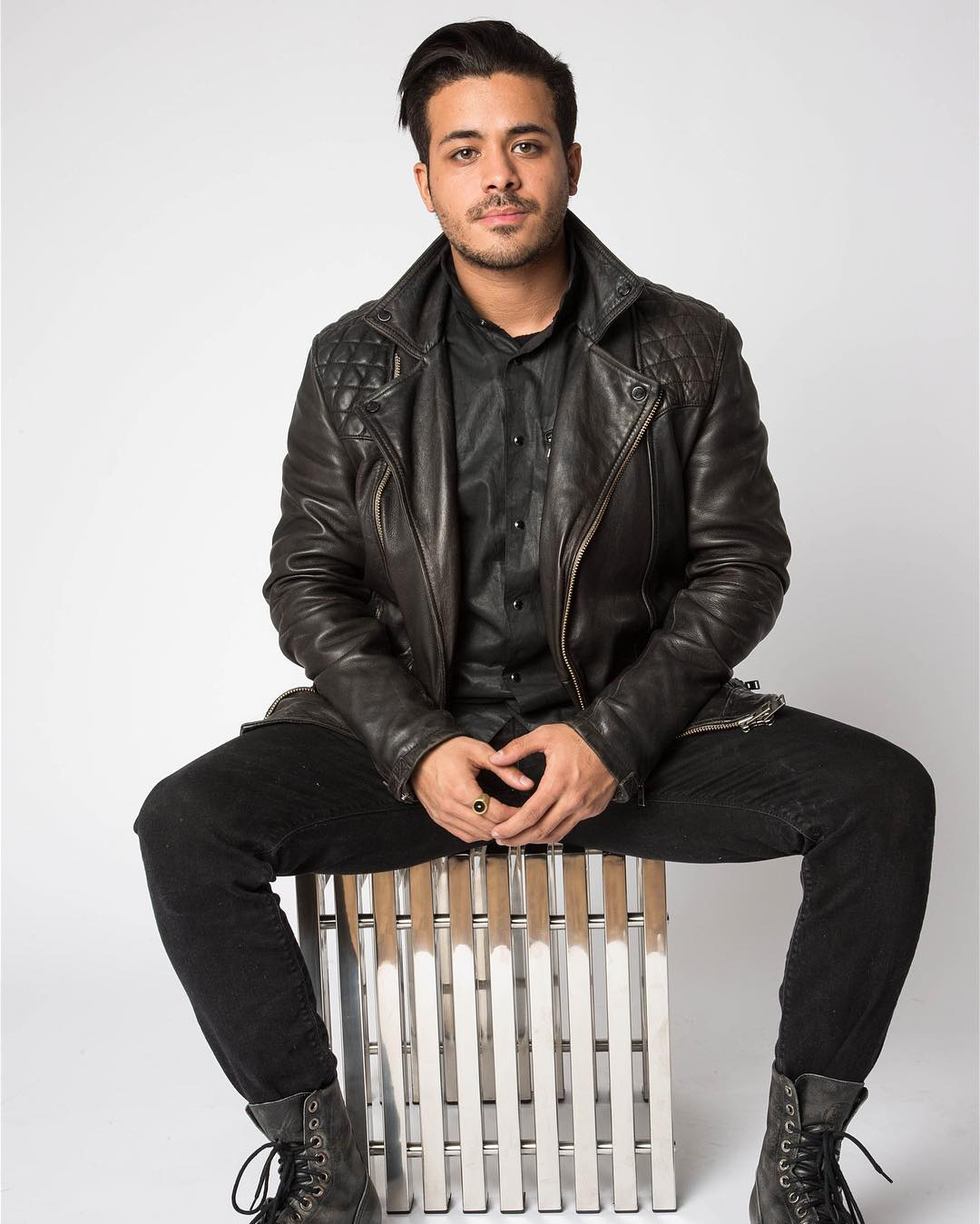 Christian Navarro is sitting on a chair