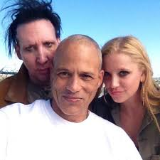 David Labrava is wearing white tee shirt