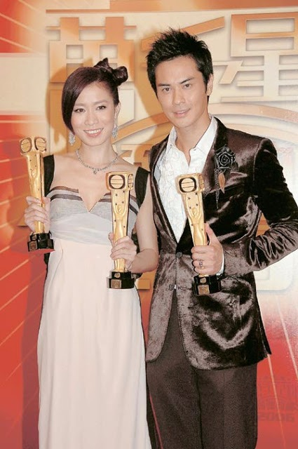 Charmaine Sheh holding two major awards and Kevin with award for Best Actor Award