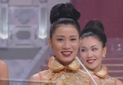 Charmaine Sheh's cheerful glance during the Miss Hong Kong Pageant in 1997