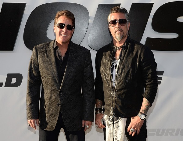 Dennis Collins and Richard Rawlings are attending the Furious 7 Los Angeles premiere. They both are wearing black sunglasses.