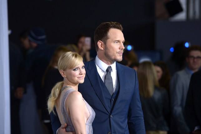 Anna Faris and Chris Pratt are standing next to each other but they are looking are different directions.