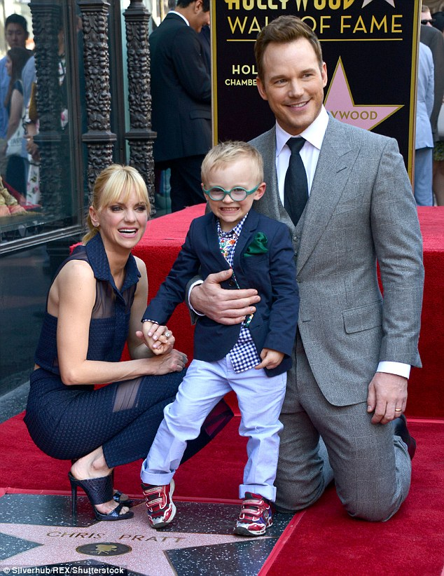 Chris Pratt is kneeling down, embracing his son Jack. Chris' wife Anna Faris is squatting beside Jack. Anna and Jack are stepping upon Chris' star on Hollywood Walk of Fame.