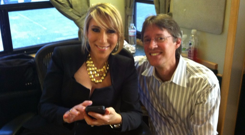 Lori Greiner with husband, Dan Greiner, she's holding a phone