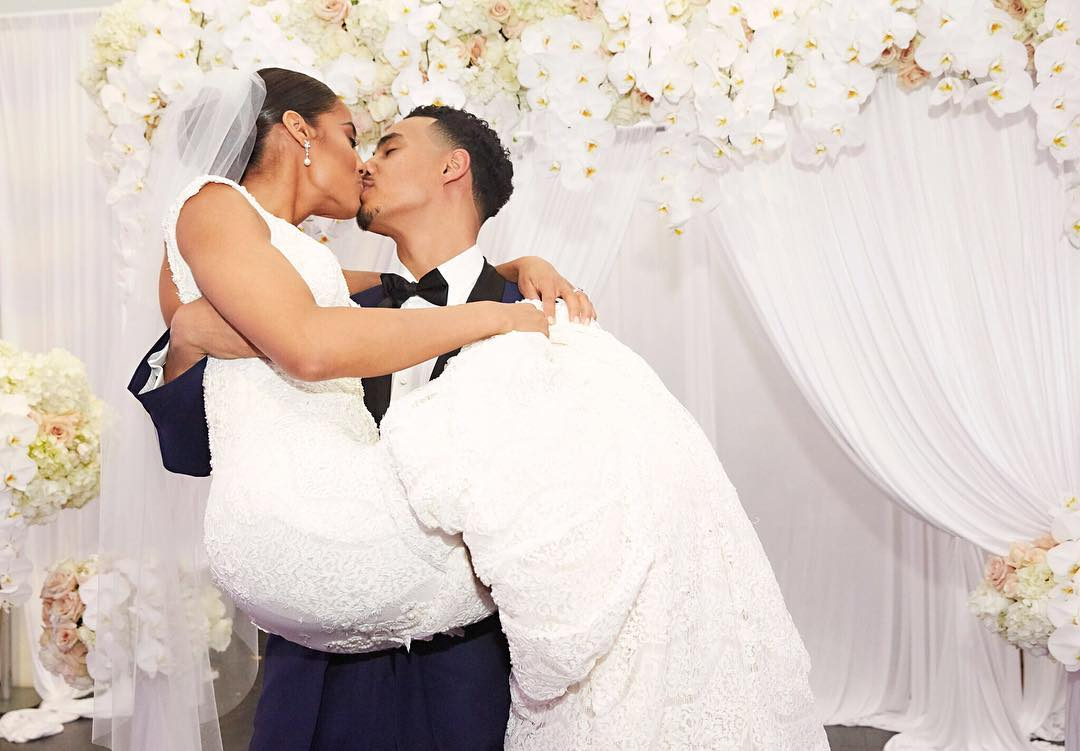Skylar Diggins' husband Daniel Smith is carrying her as they share a kiss on lips. Skylar posted this photo on her Instagram to share that the two have married.