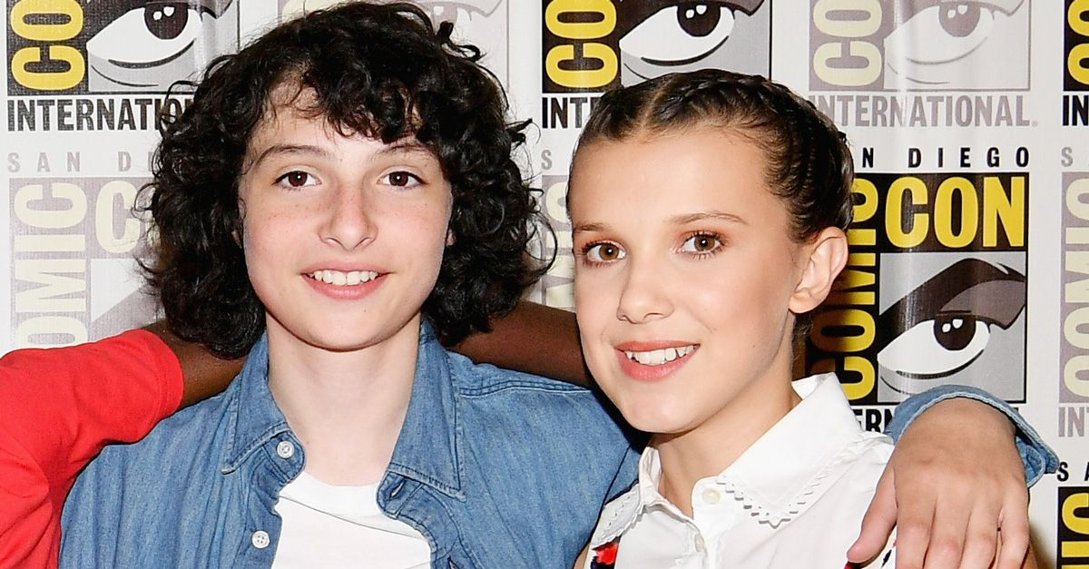 Finn Wolfhard with his co-star, Millie Bobby Brown