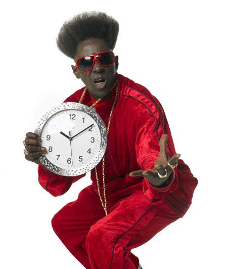 Flavor Flav posing with a big clock necklase
