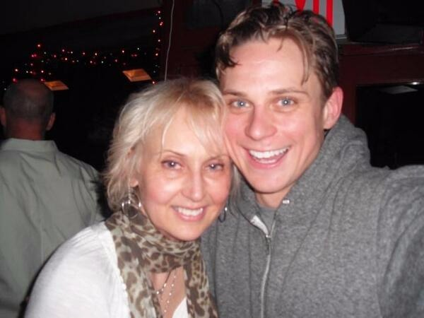 Billy Magnussen smiling while taking selfie with his mother Daina Magnussen
