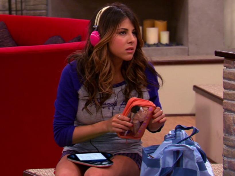 Daniella Monet's still from Victorious, a television series that she is best known for. Daniella is wearing a pink headphone and is looking sideways.