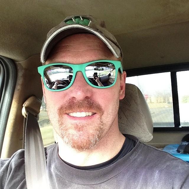 Greg Paul is taking a selfie wearing green-colored frame sunglass