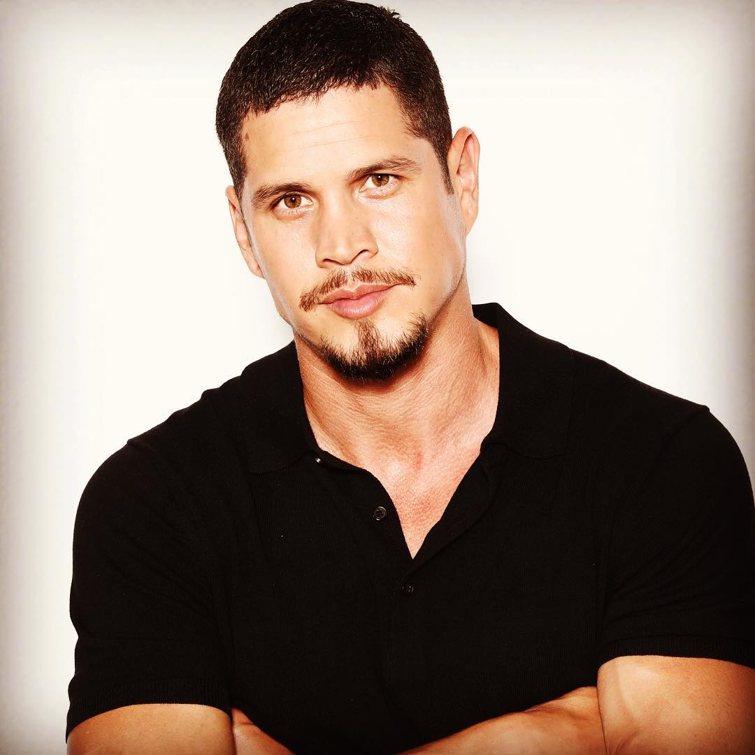 JD Pardo folding his hands with a slight smile on his face