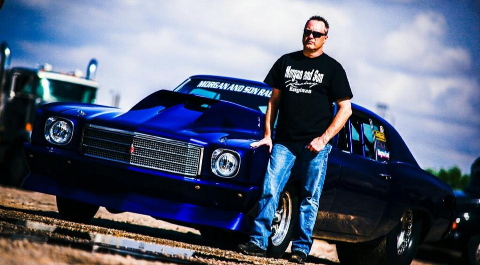 James Love is standing in front of his 1970 Chevrolet Monte Carlo named as The Street Beast.