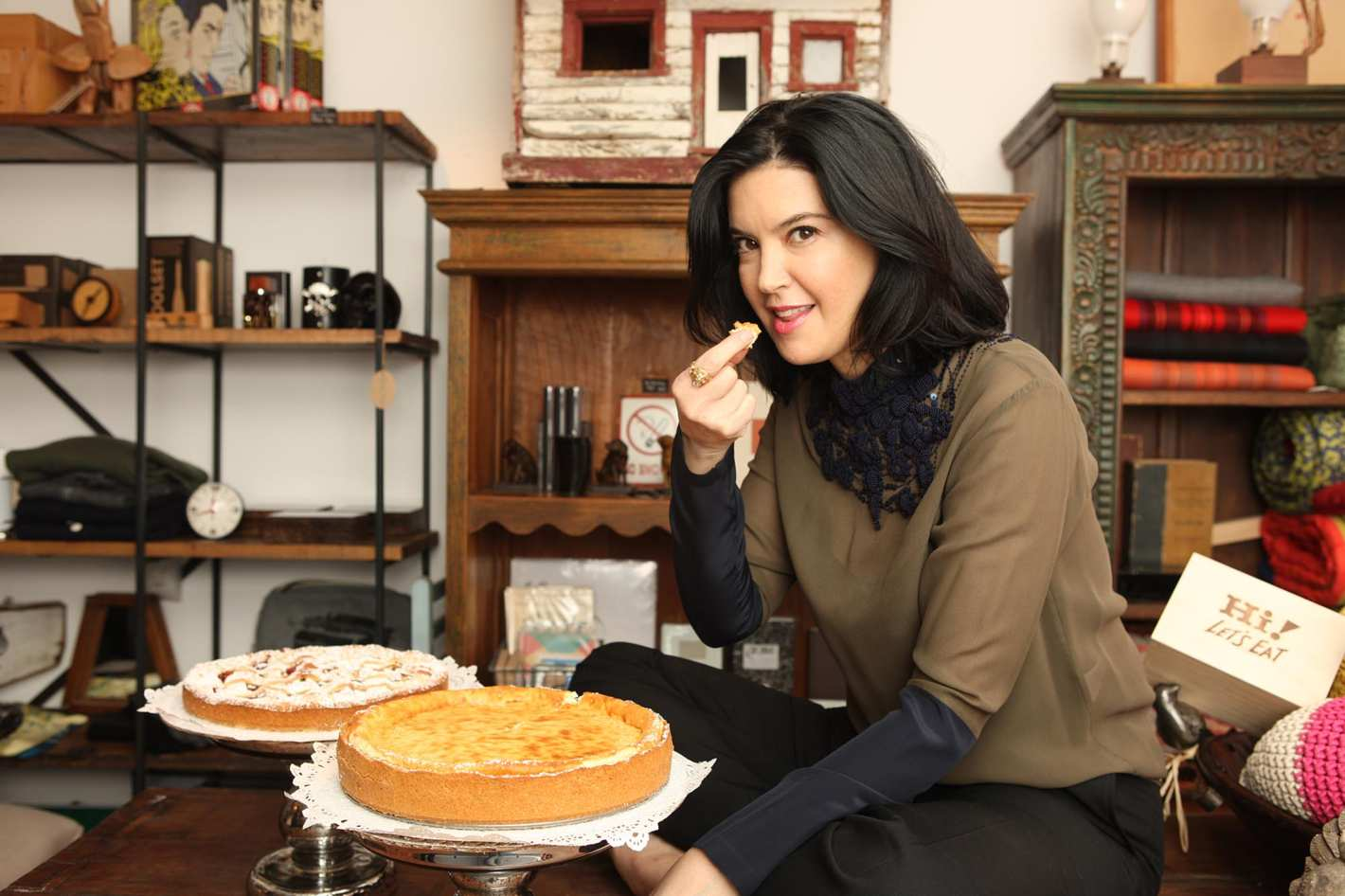 Phoebe eating a pie at her boutique