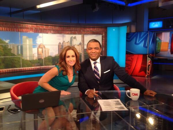 CNN corespondents Kazuki Nomura and Alison kosik posing during their show.