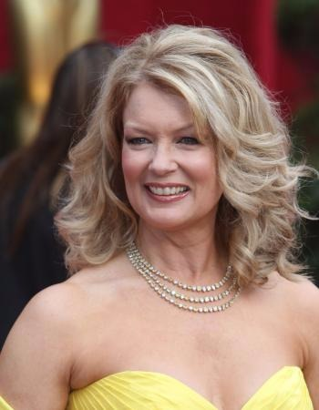 67 years of age, Mary Hart looking beautiful in her yellow dress which is best paired with her diamond necklace.