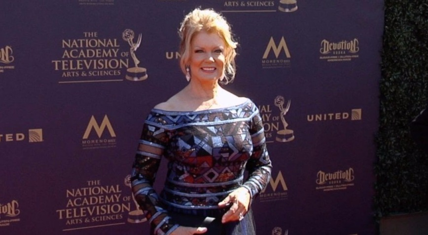 Mary Hart looking bold and smart with her blonde hair tied making it a low bun. Her multi color off shoulder dress is best suiting her. She is attending the National Academy of Television Awards.