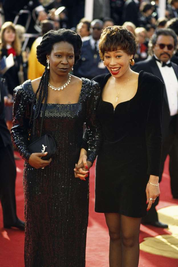 Alex Martin and Whoopi Goldberg at a red carpet event. During the mid 70's she moved to LA to help her mother pursue her stand-up comedy dream. They were low on money, and it was difficult for them to make ends meet.