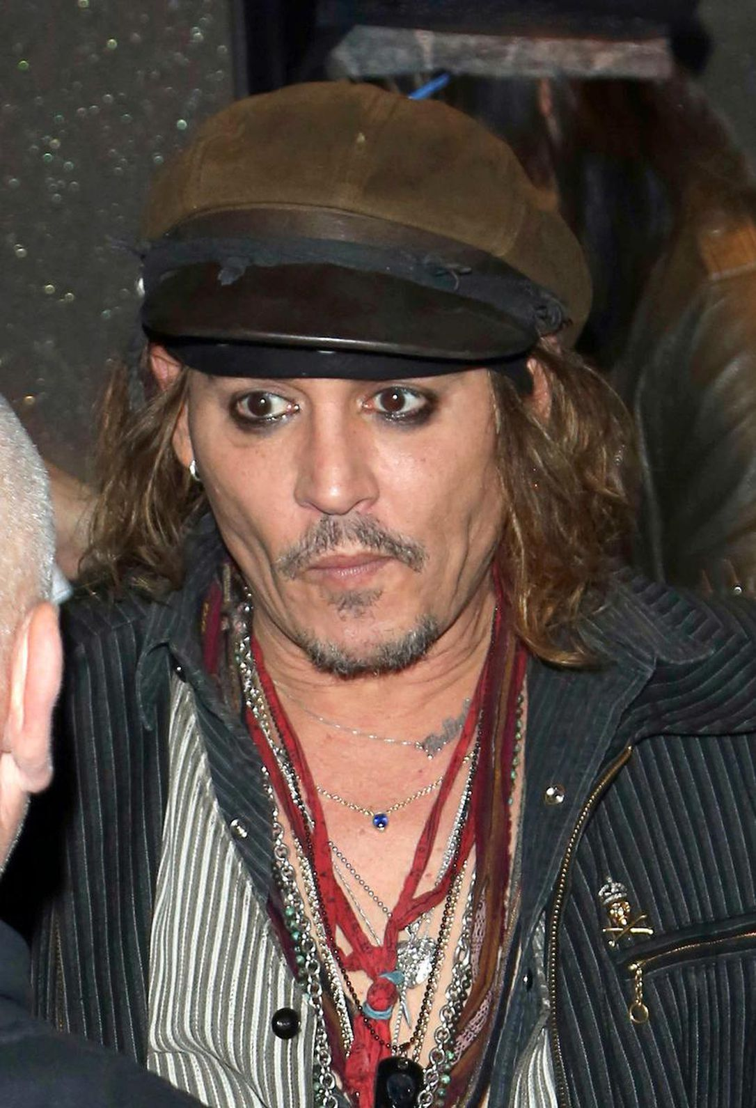 Johnny Depp wearing a cap and accessories