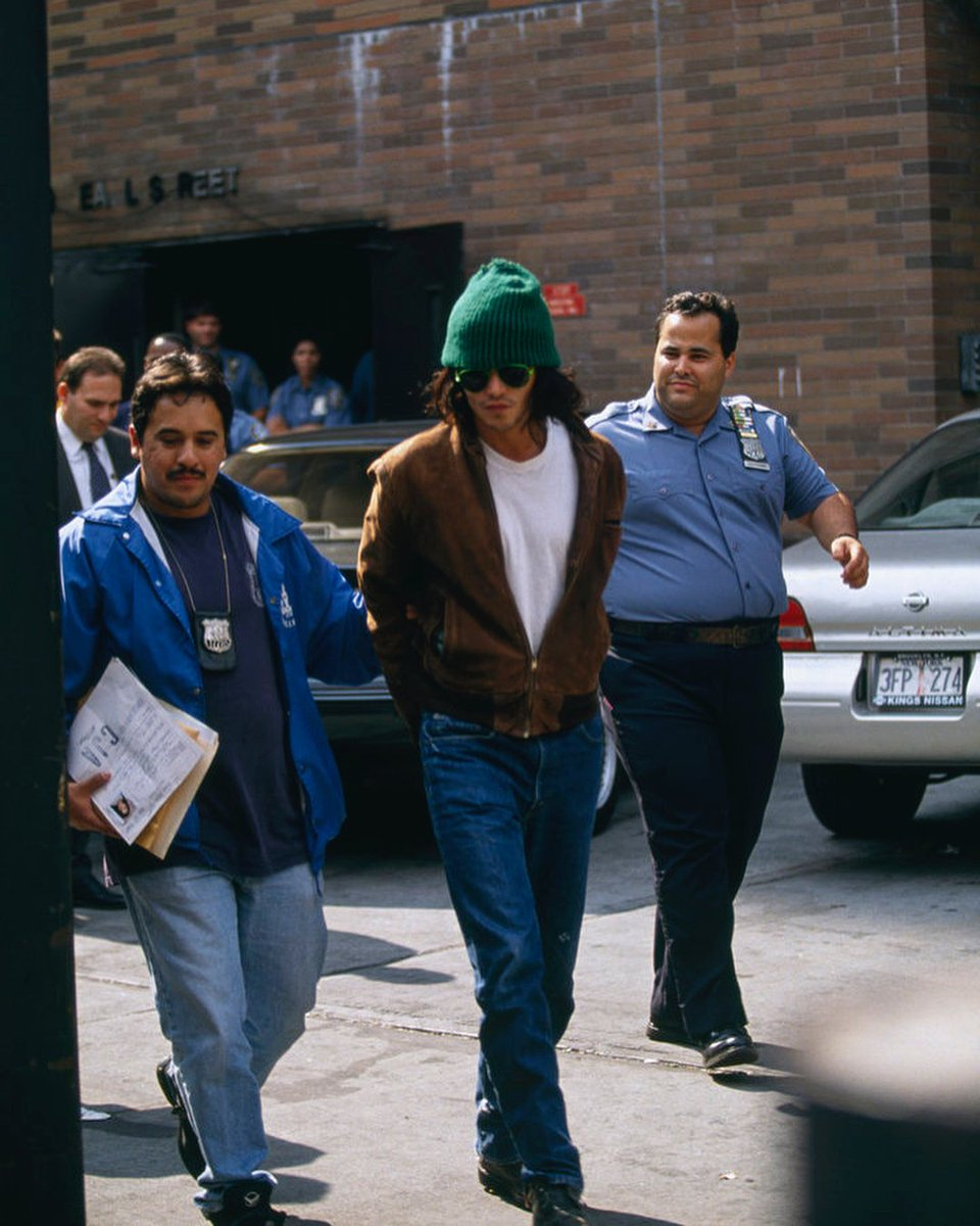Johnny Depp being arrested by the cops