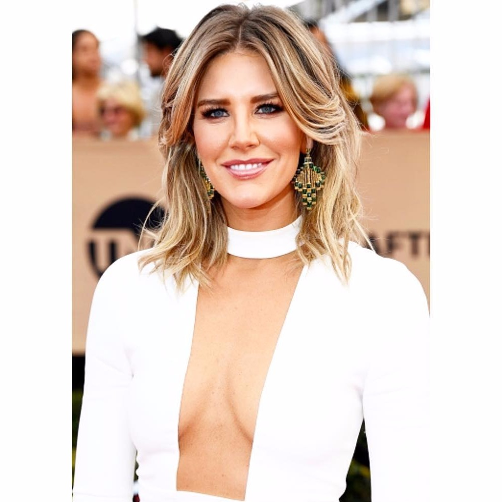 Charissa Thompson is looking beautiful in her short blonde hair, she is showing of her cleavage in her low neck white dress.