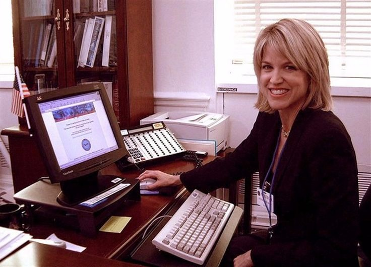 Paula Zahn smiling for a picture while working on computer