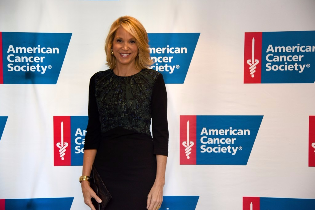 Paula Zahn looks beautiful in her black dress, she is giving a smile to the camera.