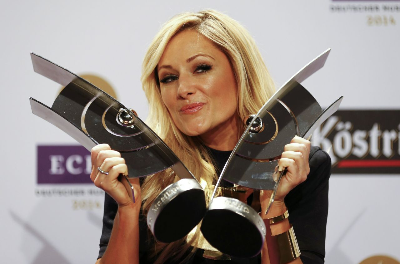 Helene Fischer posing with her Echo Awards