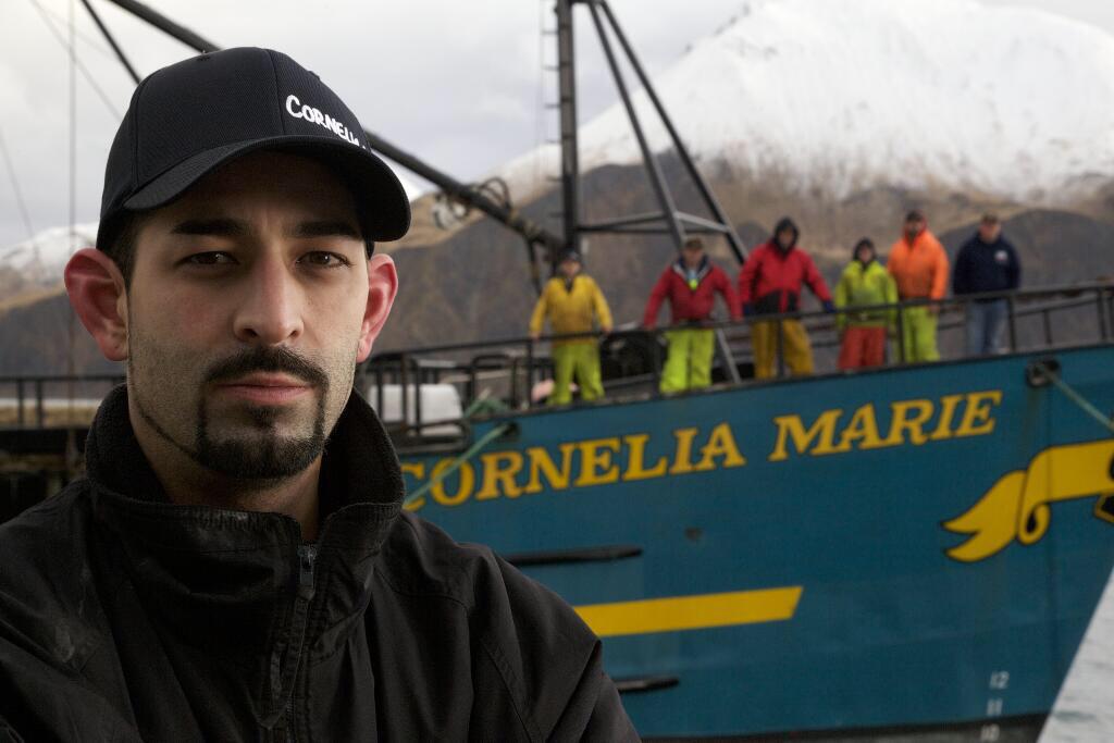 Josh Harris poses in front of his ship F/V Cornelia Marie