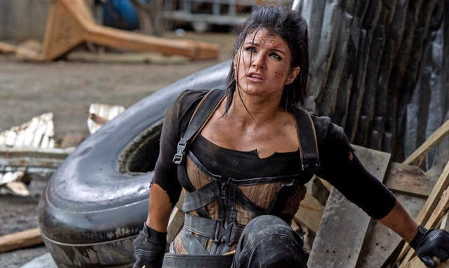 Gina Carano is wearing her a fighting costume, she is captured while she hides to rest.