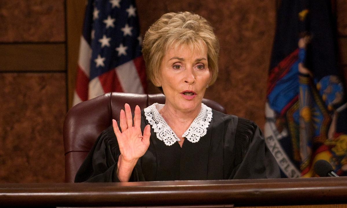 Judge Judy raising her hand