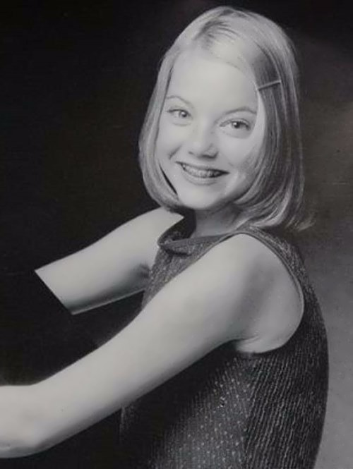 Emma Stone gives a natural smile to the camera. Emma seems quite chubby with her braces on compared to the present.