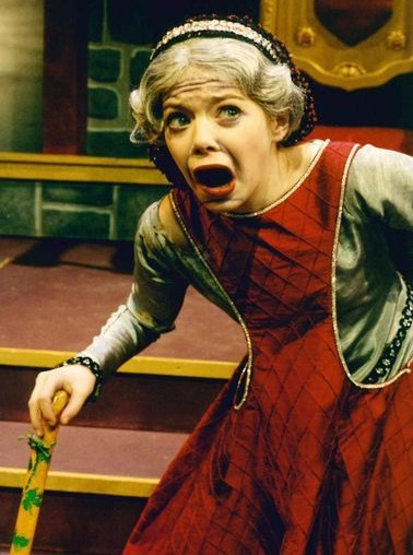 Emma Stone captured during her drama 'Princess and the Pea', where she acts as an old Queen Maude. With the walking stick, grey haired wig and mouth wide open she is too much into the character to be recognized.