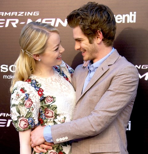 Emma and her then boyfriend Andrew Garfield, posing for the camera all wrapped up into each other.